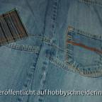 Geflickte Jeans von vorn