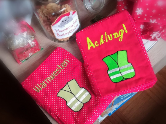 Warnwestentaschen als Geschenke