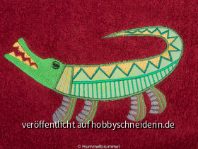 Krokodil auf Handtuch