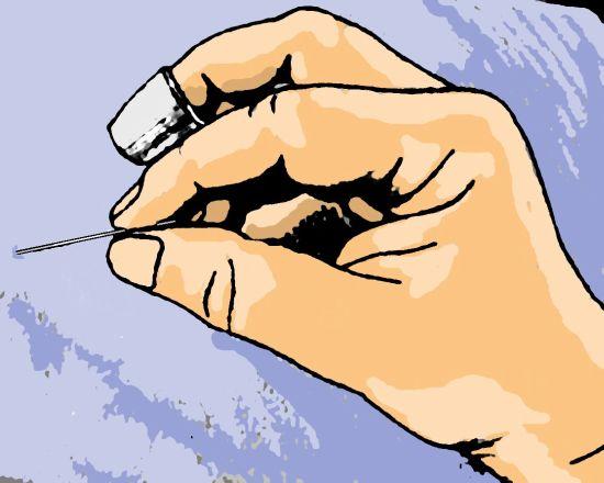 Fingerhut auf Mittelfinger